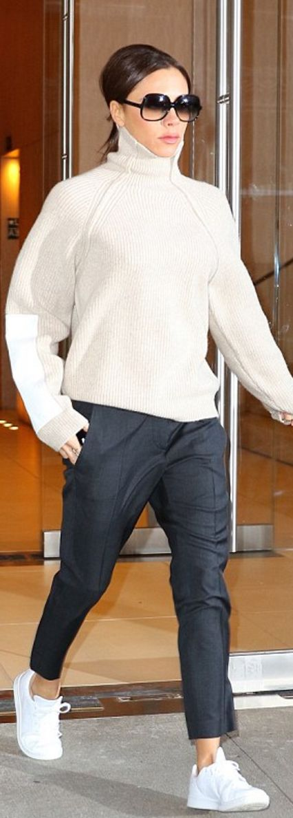Who made  Victoria Beckham's white sneakers, ribbed turtleneck sweater, blue pants, and black sunglasses?