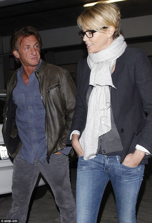 Low-key date: Sean Penn and Charlize Theron enjoyed a night at the movies amid rumours they're dating on Sunday