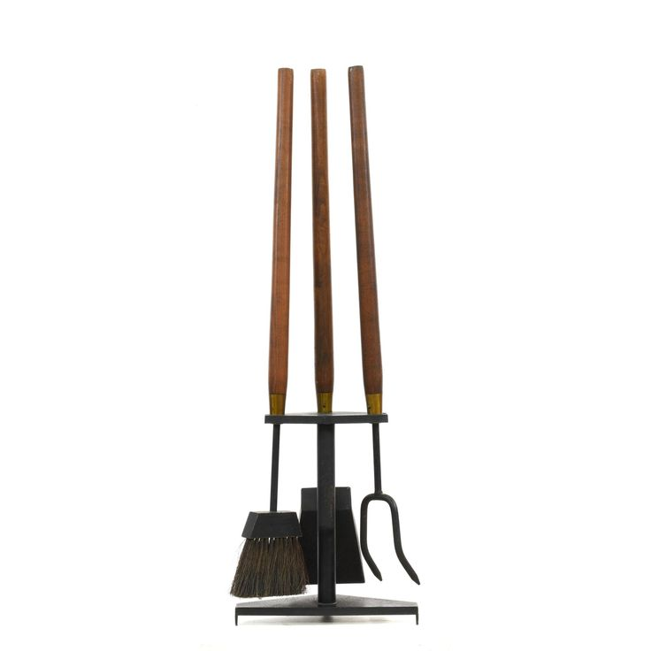 "This ""Seymour"" fireplace tool set is featured in a durable metal with a black patina finish. These mid century modern fireplace accessories have 3 tools with tapered wood handles and a diamond shaped stand. Perfect for accenting a fireplace! #midcenturymodern #decor #tools #sandiegovintage #vintagefurniture"