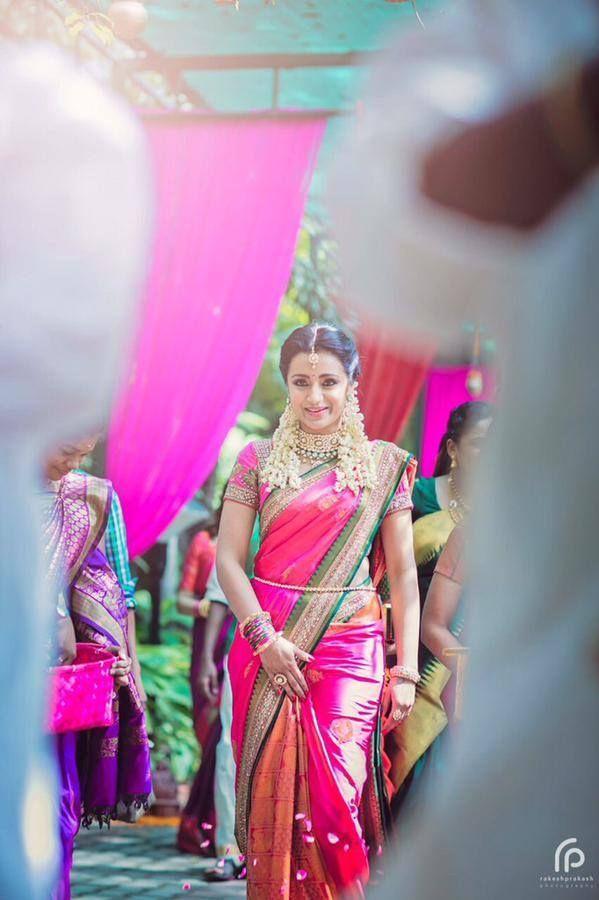 South Indian bride. Temple Indian bridal jewelry. Jhumkis.Pink silk kanchipuram sari by Neeta Lulla.Braid with fresh jasmine flowers. Tamil bride. Telugu bride. Kannada bride. Hindu bride. Malayalee bride.Kerala bride.South Indian wedding. Trisha Krishnan.