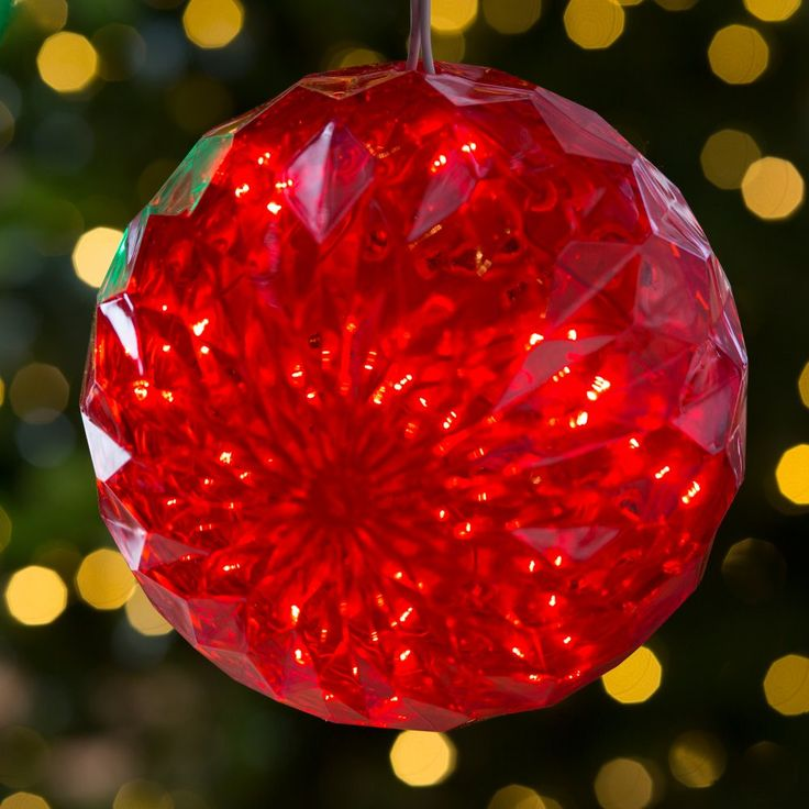 6 in. Crystal Red Sphere with 20 Red LED Lights - Create a dazzling Christmas display indoors or out with the 6 in. Crystal Red Sphere with 20 Red LED Lights. This six-inch red glass sphere features f...