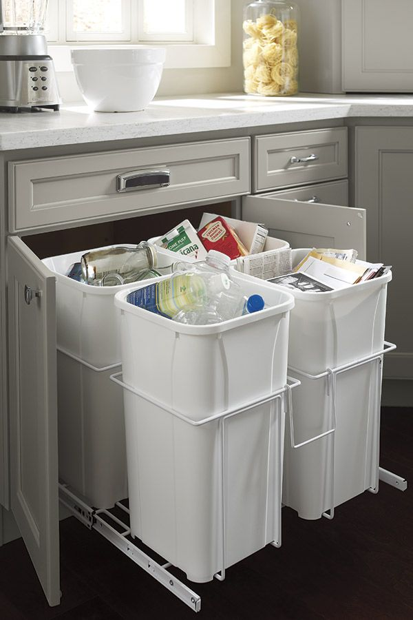 Our Kitchen Recycle Center has four baskets that are perfect for separating paper from plastic and cans from cardboard.