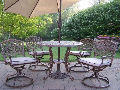 Mississippi 7-Pc Round Outdoor Dining Set by Oakland Living. $1514.30. Traditional lattice pattern and scroll work. Warranty: One year limited. Fade, chip and crack resistant. Brass hardware. Includes one table, four swivel dining chairs with cushions, tilting umbrella and umbrella stand. Includes one table, four swivel dining chairs with cushions, tilting umbrella and umbrella stand. Fade, chip and crack resistant. Traditional lattice pattern and scroll work. ...