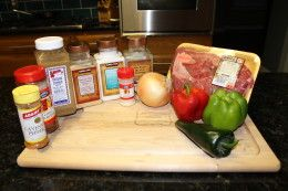Paleo Crockpot steak fajita meat. Mix the meat, veggies, and seasoning. Low for 9 hours. Perfect to come home to!