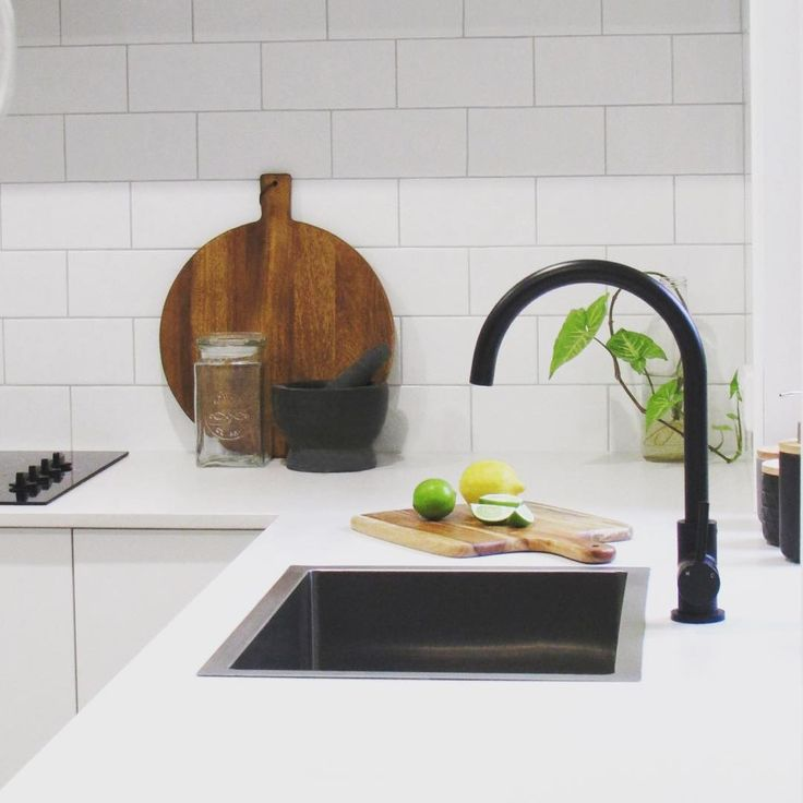 This sleek kitchen design by @thetastyplate features a range of stunning materials and finishes including polished concrete floors, and complementing concrete pendant lights, stone bench tops and our matte black kitchen mixer which make an amazing combination. ⠀ meiraustralia#Meir #Meirblack #Meiraustralia #Blacktapware #Matteblacktapware #architecturelover #architecturaldesign #interiorstyle #interiorinspo #interiordecorating #interiorandhome #interiorlovers #homeinspo #homestyling…