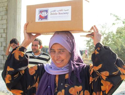 The Christian community in Jordan and Lebanon has become a key source of practical and emotional support for thousands of Syrians who have lost everything.  This Syrian woman is grateful for her Bible Society aid package.