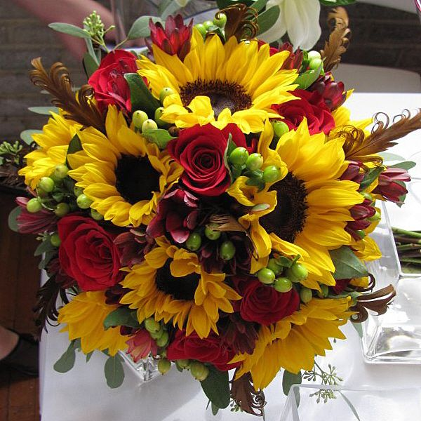 Sunflowers, roses and hypericum berries bouquet.