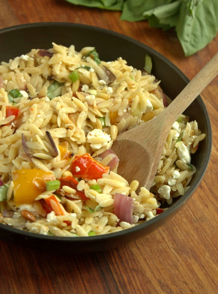 Ina Garten's Orzo with Roasted Vegetables. I made this yesterday. SO FREAKING GOOD! Will definitely make again.