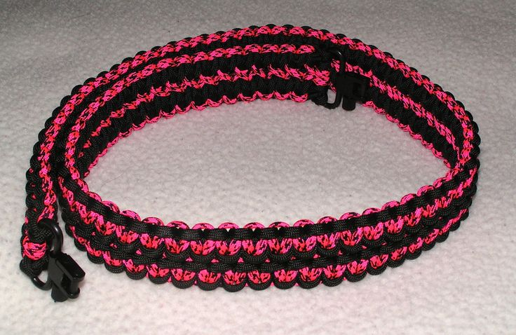 """PS12 - A Double Cobra Stitch Gun Sling, made of """"Black"""" and """"Pink Panther"""" with Blued Spin Button style swivels. - pinned by pin4etsy.com"""