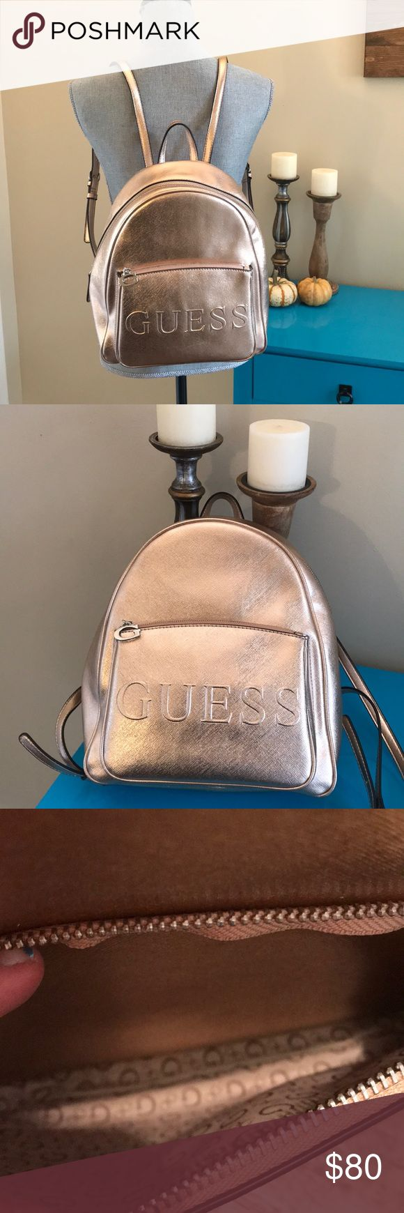 FINAL PRICE! GUESS! Rosegold backpack!! Gently used rose gold backpack!!! Has front pocket and tons of room inside!!! Has two adjustable straps on back!! Minor marks on bottom of bag! Not noticeable as they are on bottom parts of bag! ( see last few pics for marks) Guess Bags Backpacks