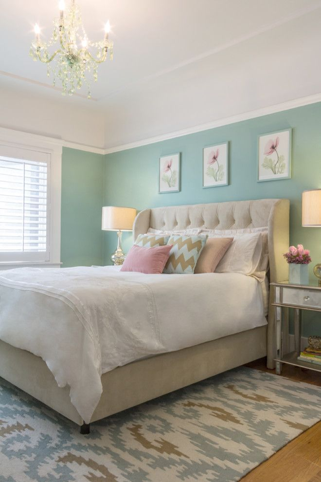 Chic bedroom with teal wall, chandelier, white blue and brown rug, wood shutters, flower art   Miss Alice Designs