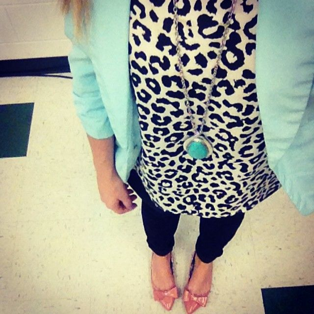 Like the print of the shirt with the colorful blazer or make it a cardigan