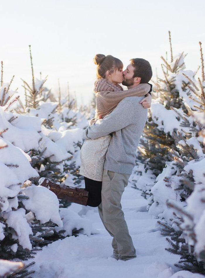 In what other season can you justifiably wear a sequin dress for your engagement photos? End your winter photo session by grabbing your favourite bejewelled frock and heading out for a sweet kiss amidst snow-capped trees.