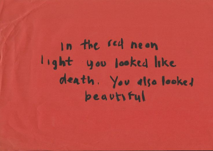 In the red neon light, you looked like death. You also looked beautiful.