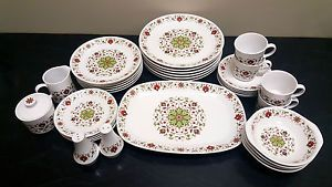 This retro Noritake set contains 34 pieces, on a white background with an attractive floral design in shades of green, brown, taupe and red. This set was produced in the 1970's in Japan. The manufacturer's number is 9076.Follow the link to check it out on our eBay page
