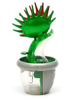 Artificial Venus Fly Trap. I need this for my desk! I hate bugs but I don't really want to kill them or water a creepy ass moving plant lol. This is genius!
