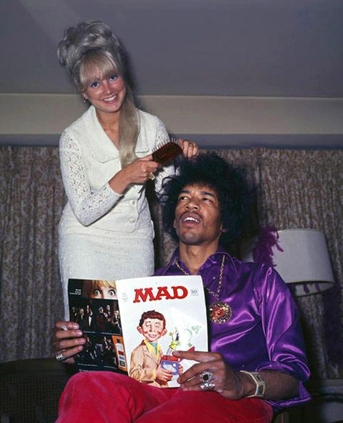 Jimi Hendrix reading MAD magazine while getting a hairdo. It looks like he has just remembered something...