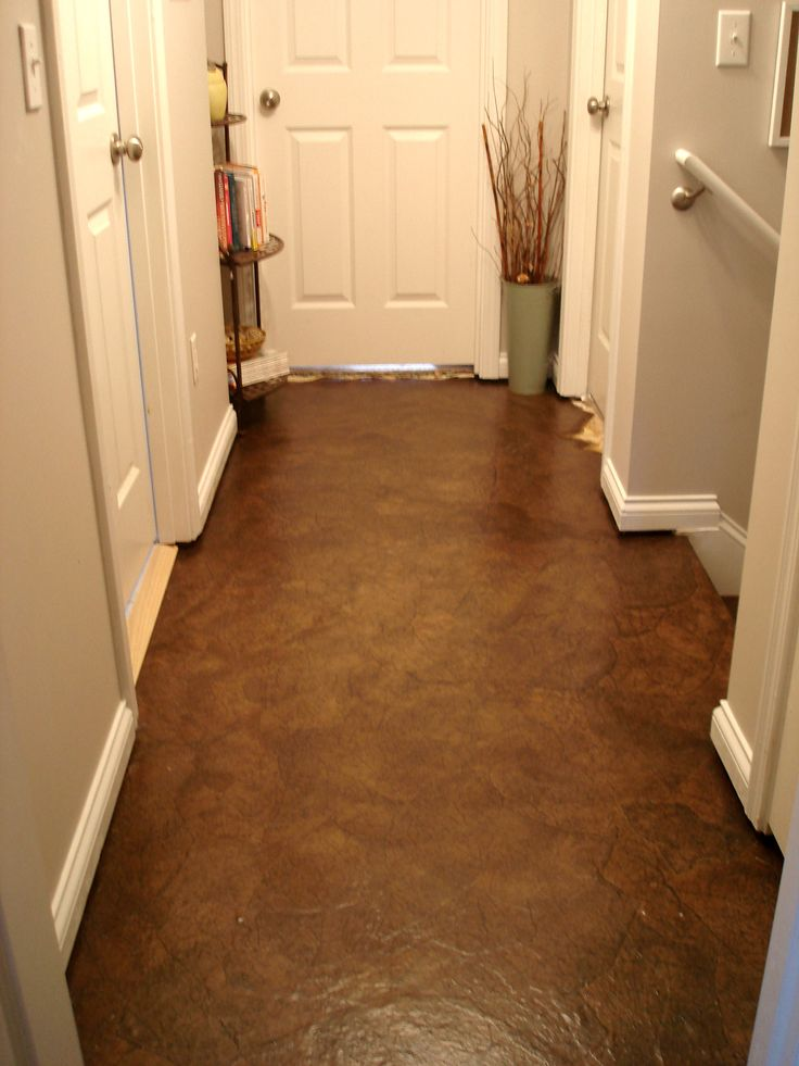 Hallway Makeover- This is an awesome floor project. Brown paper bags torn up, stained, and then 8 coats of polyurethane. Looks like a leather floor. Full tutorial of this project.