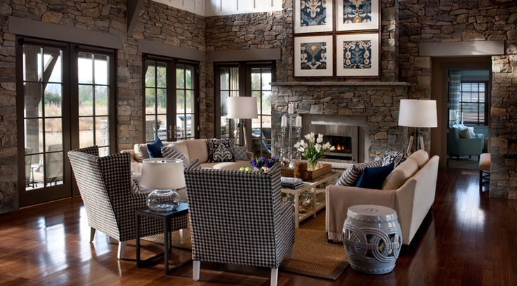 Part of the 2012 HGTV Dream Home, this Great Room has stone walls with warm wood floors. The furniture, however, is not my taste.