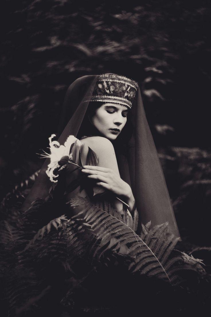 "darkbeautymag:  ""Lady with the Lily"" — Photographer: Vivian AinsaluModel: Liisi Tarve"