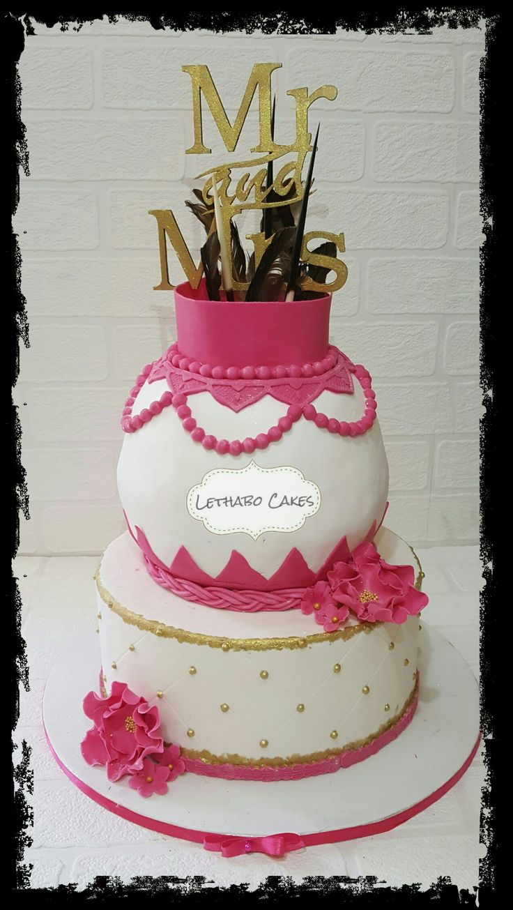 Pink and white traditional wedding  cake