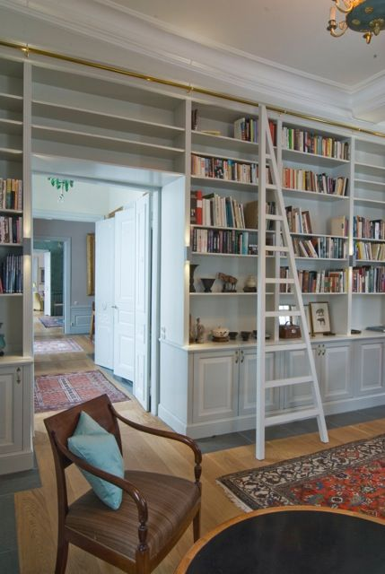 The study has a new bookshelf with a ladder on a rail. #Bespoke #Bookcase #BookcaseAroundDoor #Bookshelf #BuiltIn #BuiltInBookshelf #BuiltInShelves #Custom #Desk #Gentlemen #GreyScale #GreyWalls #Joinery #Ladder #LadderOnRail #Library #MovableLadder #Office #OldSchool #PersianRug #Shelves #ShelvesAroundDoor #SmokingRoom #Study #Vintage