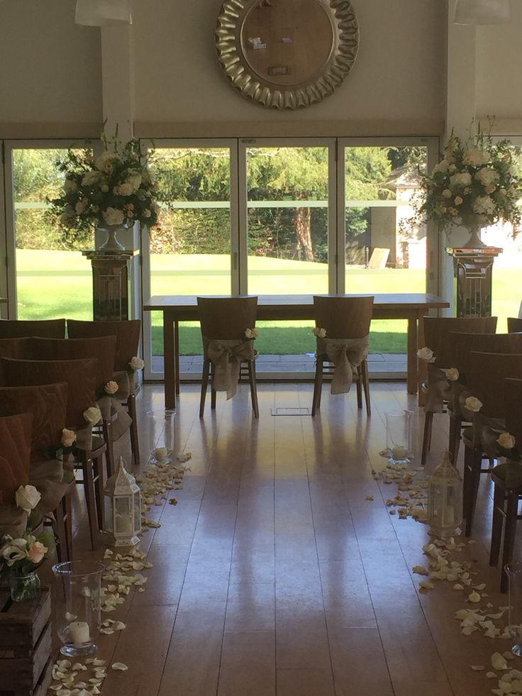 Stunning ceremony room at Wasing Park. Flowers by Ruby and Grace. Hesssin chair sashes by Fuschia.