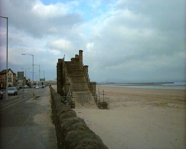 Swansea beach and remains of footbridge by Steve Rigg