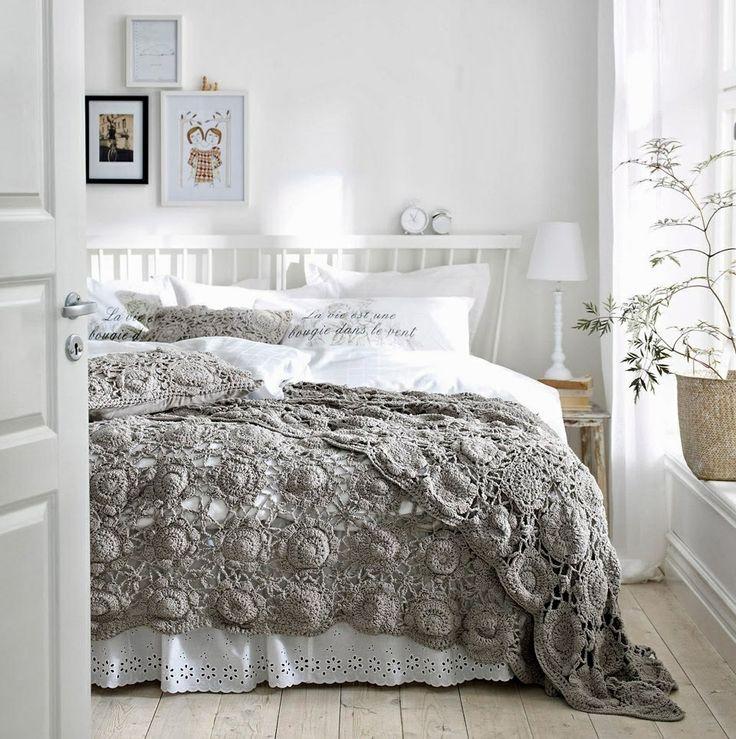 Pretty crocheted bedspread in gray.
