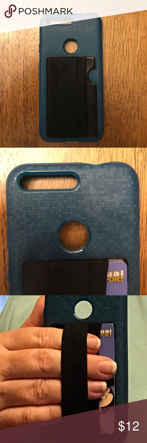 """Teal cell phone case for Google Pixel, nearly new. Teal TPU cell phone case for Google Pixel, nearly new. Used for a week, then decided to switch phones. Has """"lay-on-the-table"""" design that helps protect display from damage. Has a cool pixel pattern. I attached a card holder with an elastic strap to put your fingers in. It is removable, and the company says it will leave no residue. Diztronic Accessories Phone Cases"""