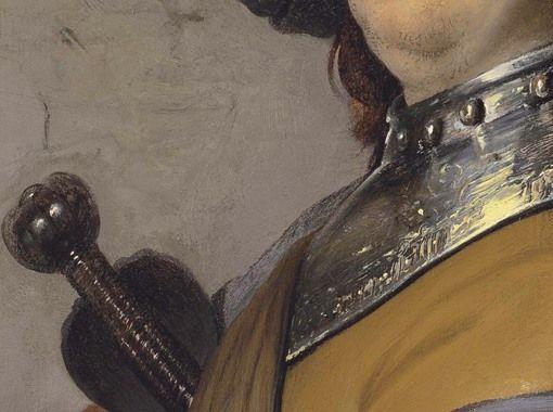 Particolari numero 4. Rembrandt: Ritratto di uomo con collare d'armatura e cappa. Olio su tavola di quercia del 1626-27. 39,8 X 29,4. Collezione privata. Regge sotto l'ascella la spada dalla strana elsa: la dura lucentezza del metallo riflette magnificamente la luce: era il massimo Maestro, nell'uso di questi riflessi.