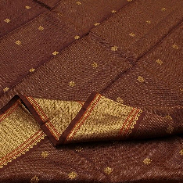 Revel chocolate brown's undisputable majesty and charm with this dramatic Sarangi creation. The chocolate brown body is deliberately streaked, adorned with golden floral accents. The pallu meanwhile is a lush scene of nature, featuring leafy plants, flowers, mangoes, and humble creatures such as elephants and deer—all of them luxuriously woven in #zari. View more Kanjivarams in this range at #Sarangi. Code 580123805.