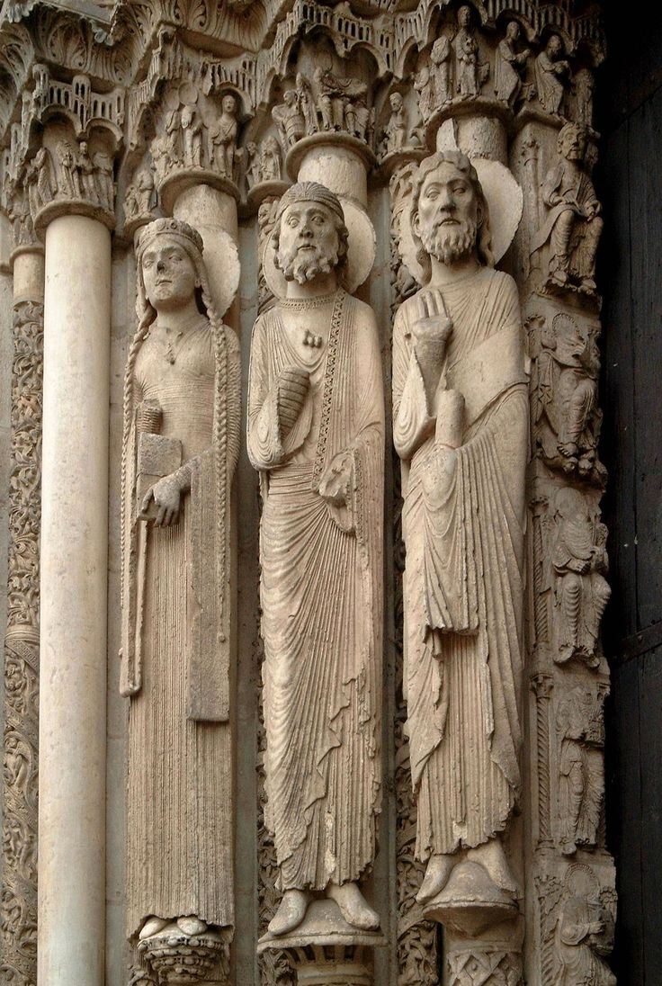 From Wikepedia page on Gothic art a good pic of Chartes cathedral (ca. 1145).  Thought to depict bliauts since these are important people of the royal court.