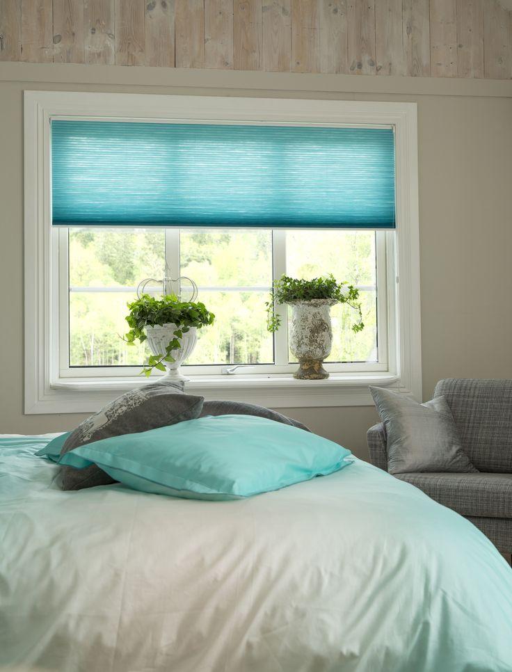Stunning turquoise, energy saving Duette Blinds.