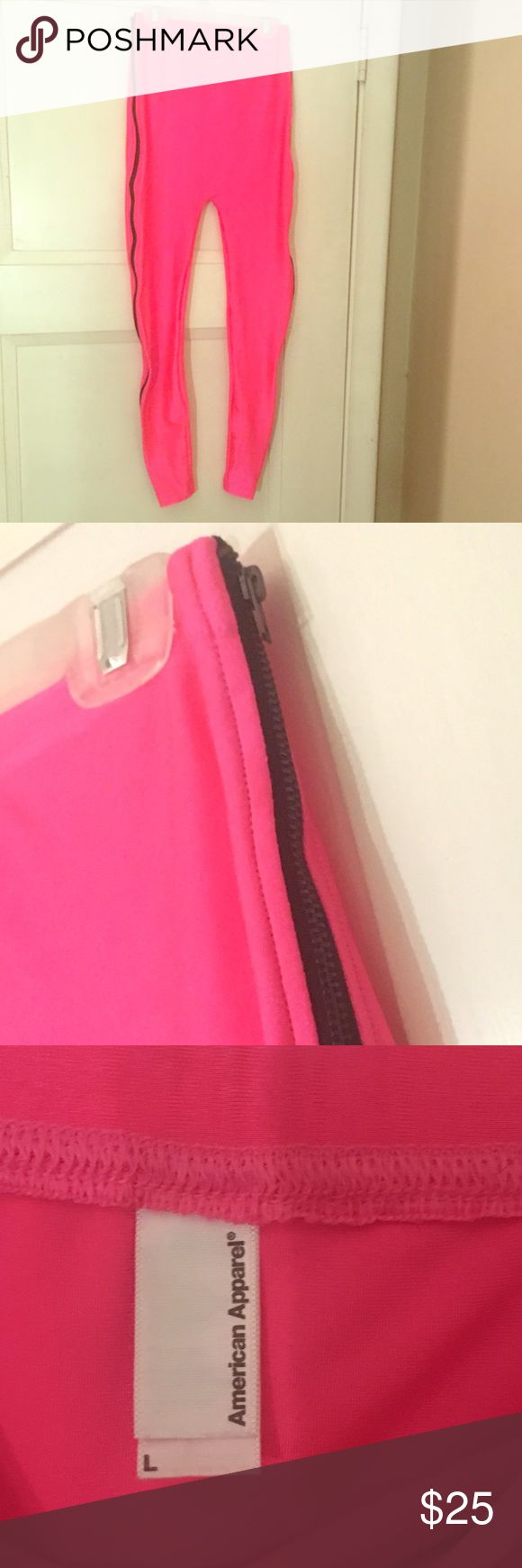 American apparel hot pink zip up leggings L American apparel hot pink shiny & crazy but cute zip up leggings size L black zip up all the way on each side outside. worn once in perfect condition Electric Yoga Pants Leggings