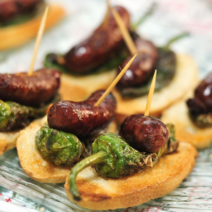Pinchos made with chorizos and Padron peppers