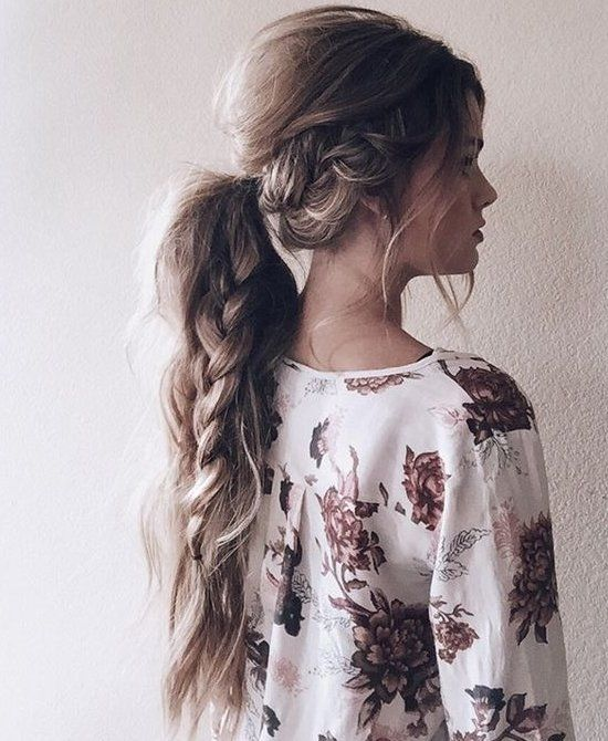 13 Easy Summer Hairstyles Your Inner Mermaid Will Love: This cool braded boho ponytail is the perfect hairstyle for your favorite summer music festival or for a lazy day at the beach