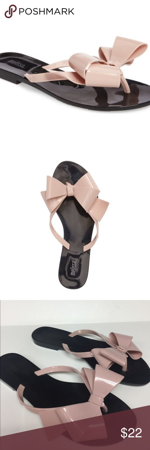 Melissa Harmonic Bow III Pink Flip Flip Sandal An oversized pink bow sets on top of  a simple flip-flop  sandal. Molded from fruit scented PVC. Black bottom with pink bow. Made in Brazil. Durable flexible and recyclable. Worn only a couple times. Melissa Shoes Sandals