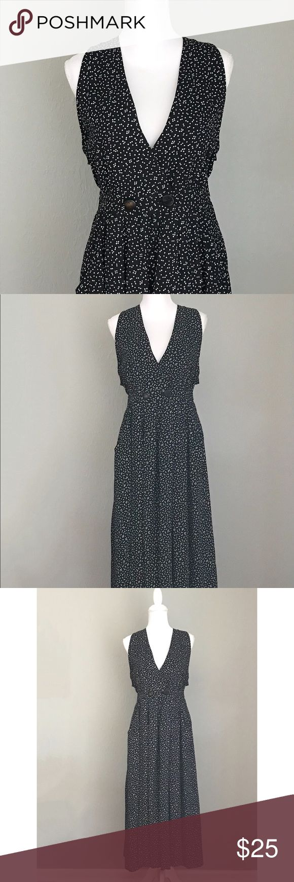 1980s Polka Dot Jumpsuit Black Polyester jumpsuit with white polka dots. Wide legged with pockets. Great Condition! Fits like modern M-L. Vintage Other