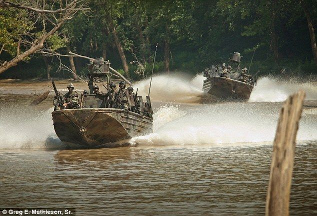 By land and by sea: Special Warfare Combatant-craft Crewman (SWCC) move though rivers at a high rate of speed in specially designed Riverine boats outfitted with heavy weapons