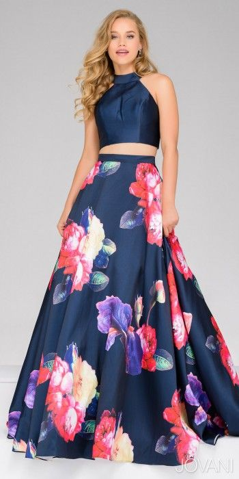 Take your wardrobe to the next level with this Mikado Two Piece Floral Print Prom Dress by Jovani. This dress includes a high collar halter neckline with a concealed center back zipper. The skirt of this dress features an A-line silhouette with a center back zipper and a vibrant Mikado floral print with a train. #edressme