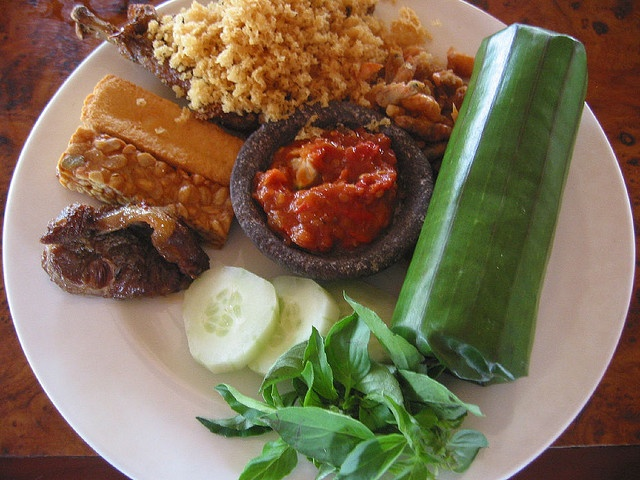 Nasi timbel...one of many variant Indonesian fragrant steamed rice wrapped in banana leaves ...