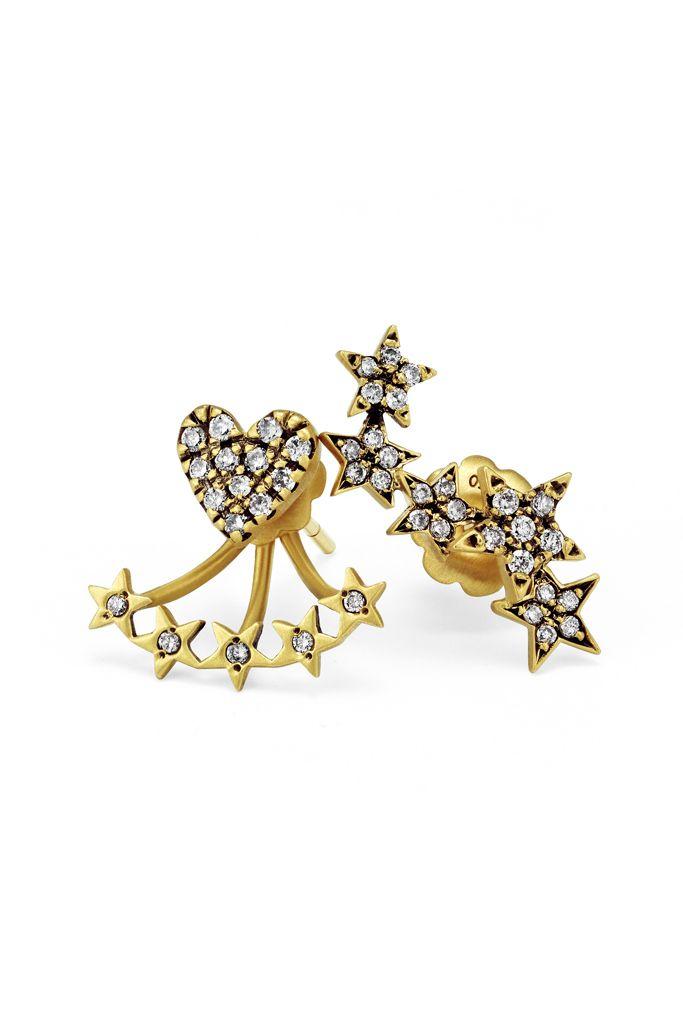Suel's 18-karat blackened gold studs and ear jackets with diamonds.