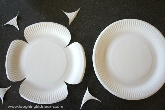 Cutting paper plates for anzac day craft