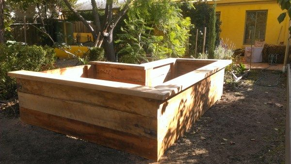 L-shape ironbark veggie bed with seating designed & built by Yummy Gardens Melbourne