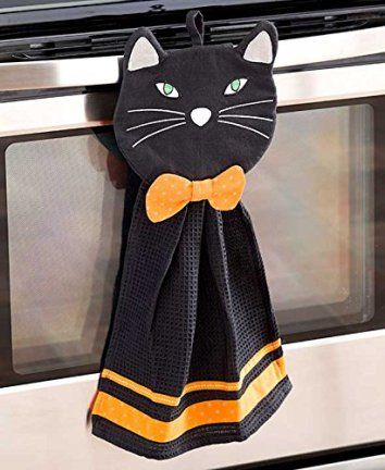 2 Pc Towel & Pot Holder Halloween Kitchen Set (black cat) Despite the folklore and superstition around black cats I absolutely love them. Year around but especially on Halloween. This is why I love to use creepy, spooky and wicked Halloween black cat home décor. You will find all kinds of creepy kitty cat decorative accents from black accent pillows to inflatable black cats to even some cute black and cat and witch décor.