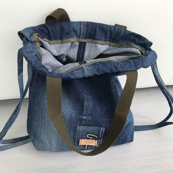 Repurposed GSTAR RAW Denim drawstring backpack and/or tote bag Unlined, one zippered pocket on the back side Measurements: Width and length: 40 cm (16 in) Depth: 10 cm (4 in) Shoulder strap length 51 cm (20 in) width 3.5 cm (around 1.25 in) Drop length 21 cm (8.5 in) Drawstring