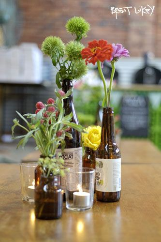Beer bottle vases on food tables to show what beers we have available?