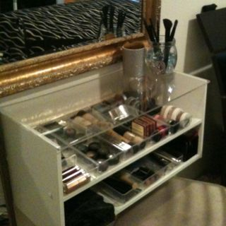 My very own DIY vanity. Buy a shoe shelf from Target, put together. Hang upside-down with L brackets. Buy Plexiglass from Lowe's have them cut it to 24x11, double tape plexiglass to shelf and bam! I bought little organizers from Target to put my makeup in. Perfect!