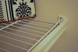 Hide ugly wire shelving with a piece of molding...great idea!